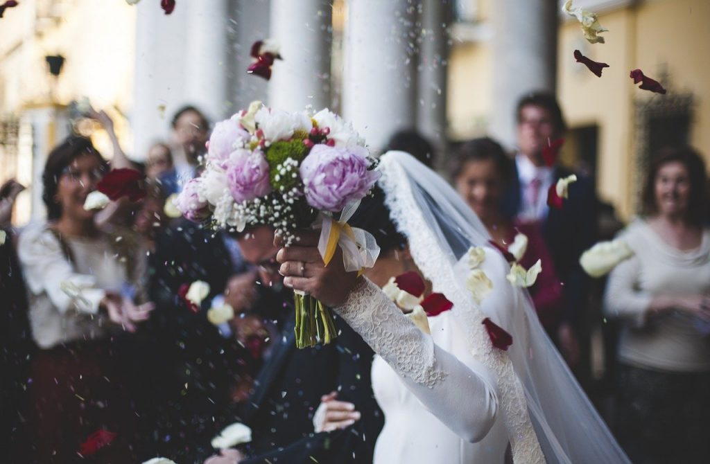 Walking down the wedding aisle with flowers
